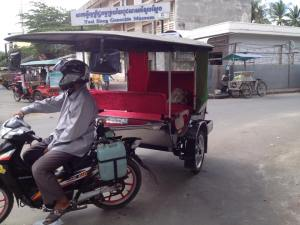 Samon, our tuk tuk driver and our awesome tuk tuk :D